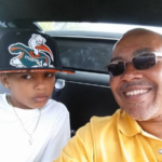 Photo of James Gibbs and son in a car